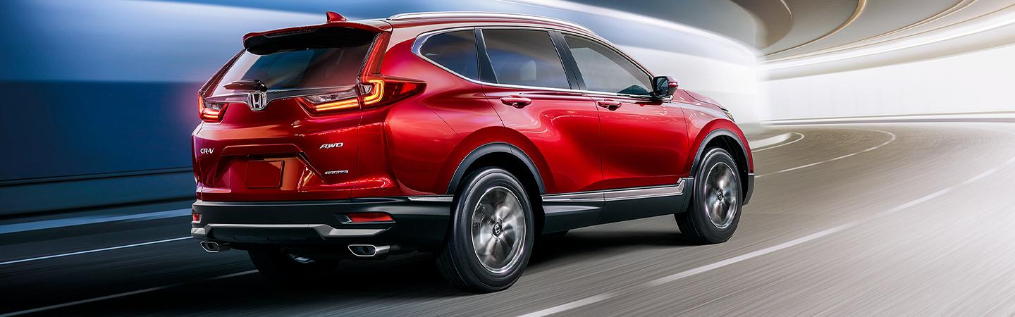 Rear view of a red 2020 Honda CR-V in motion