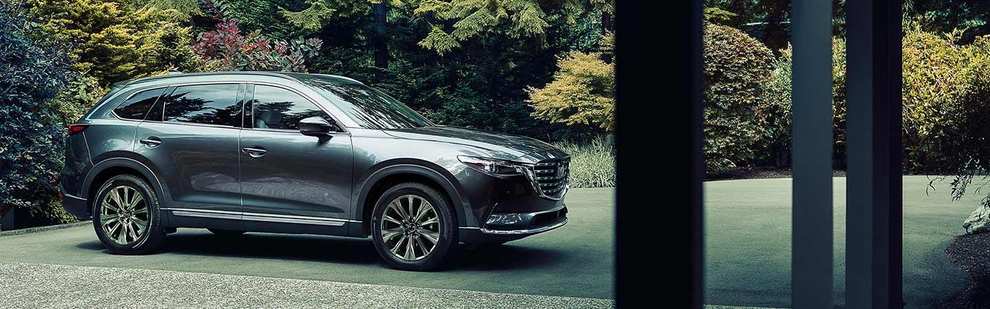 Passenger side view of the 2021 CX-9 parked
