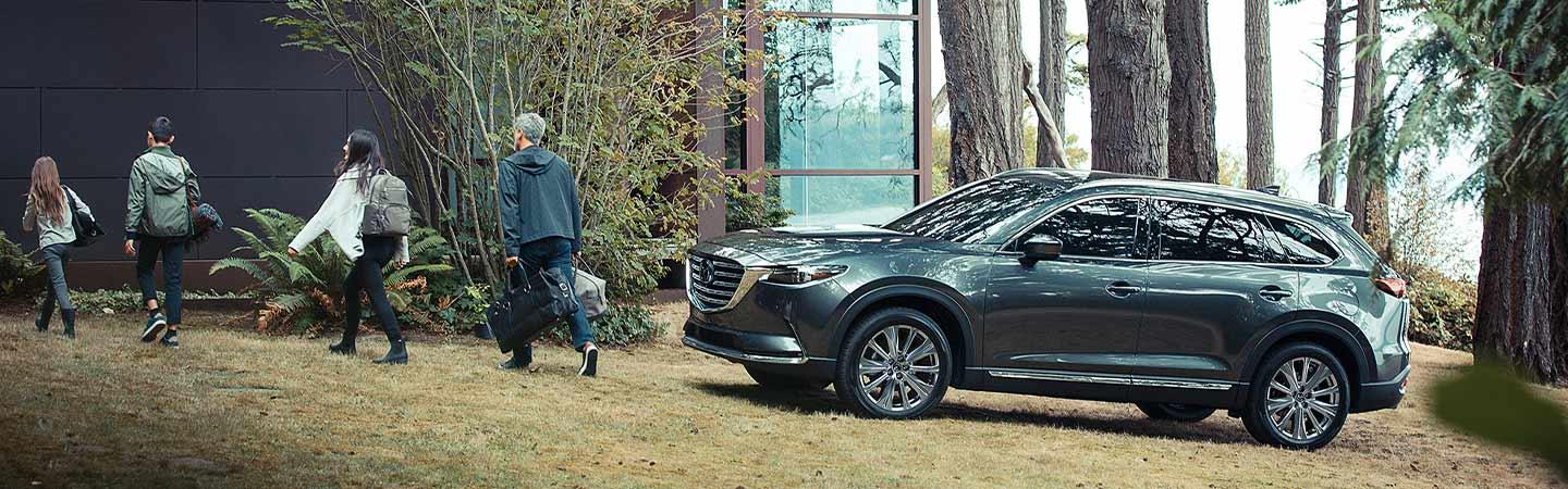 A family walking away from the 2021 CX-9