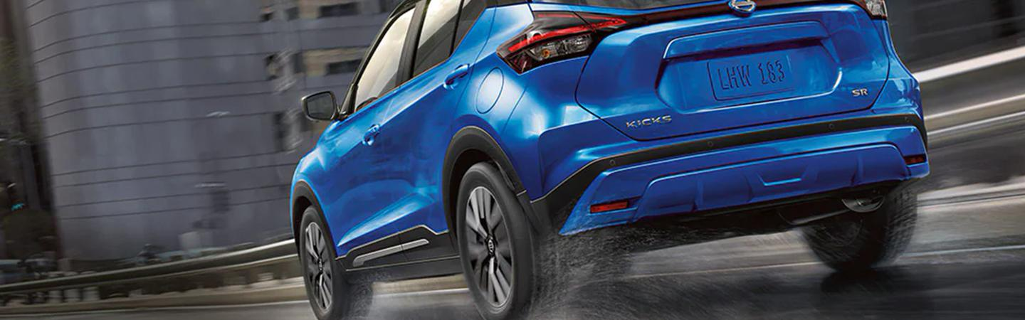 2021 Nissan Kicks driving on the wet road