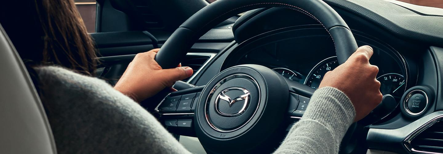 Close up of the steering wheel inside the 2020 Mazda CX-9