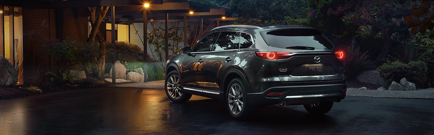 Rear view of a 2020 Mazda CX-9 parked outside a home