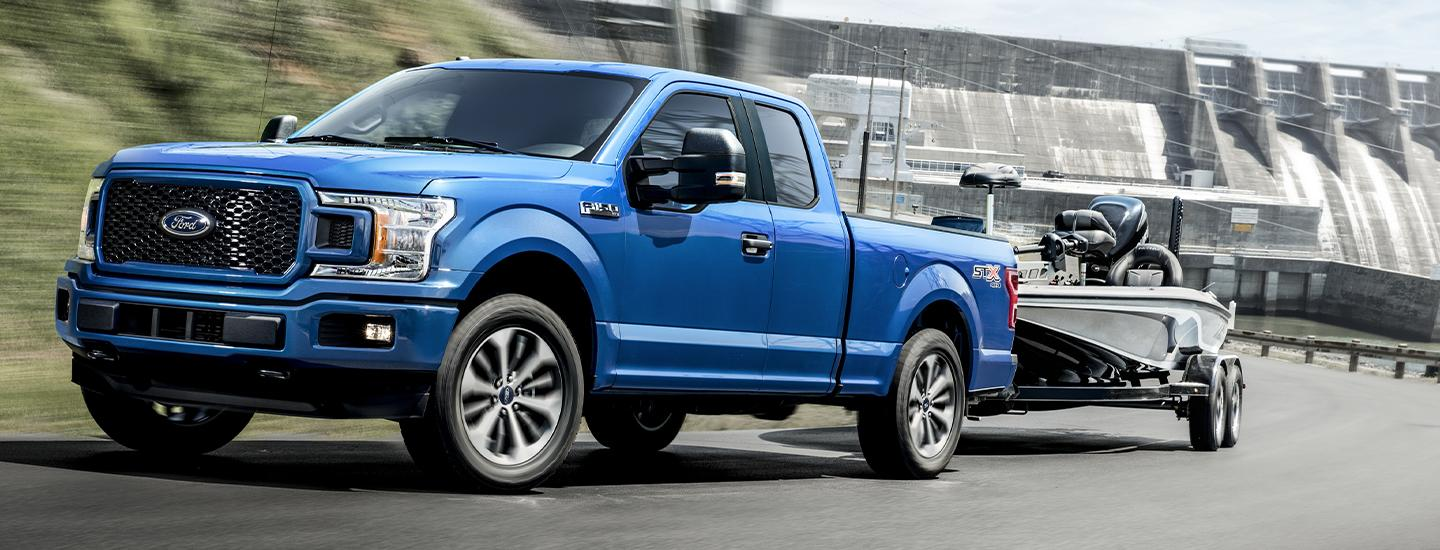 Blue 2020 Ford F-150 towing a boat