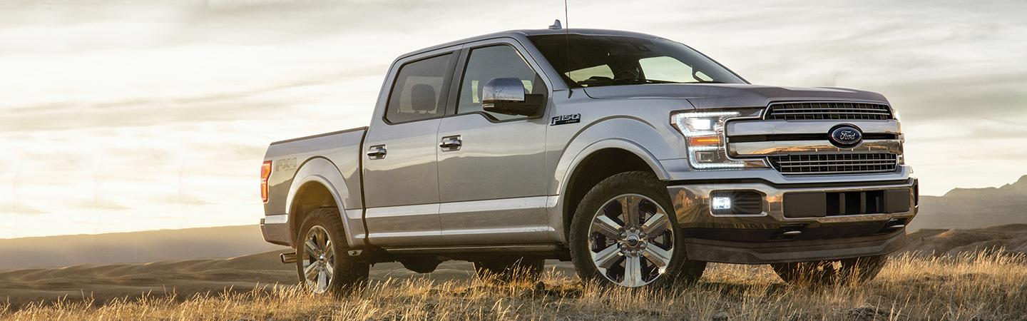 2020 Ford F-150 parked in a field of grass