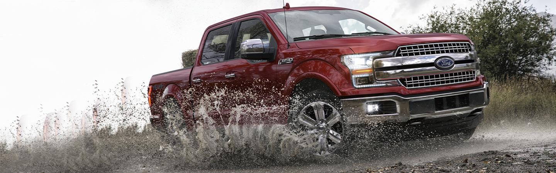 2020 Ford F-150 driving through mud