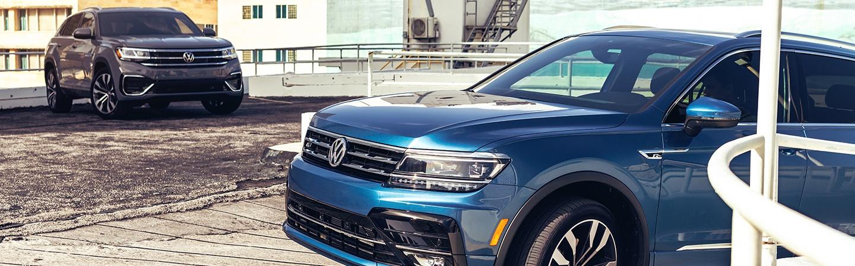 Two Volkswagen Alta's in a parking garage