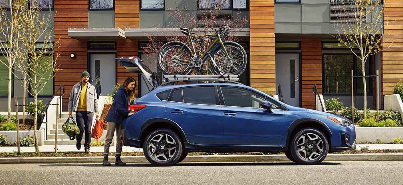 2019 Subaru Crosstrek Exterior – Man and Woman loading the Crosstrek with gear.