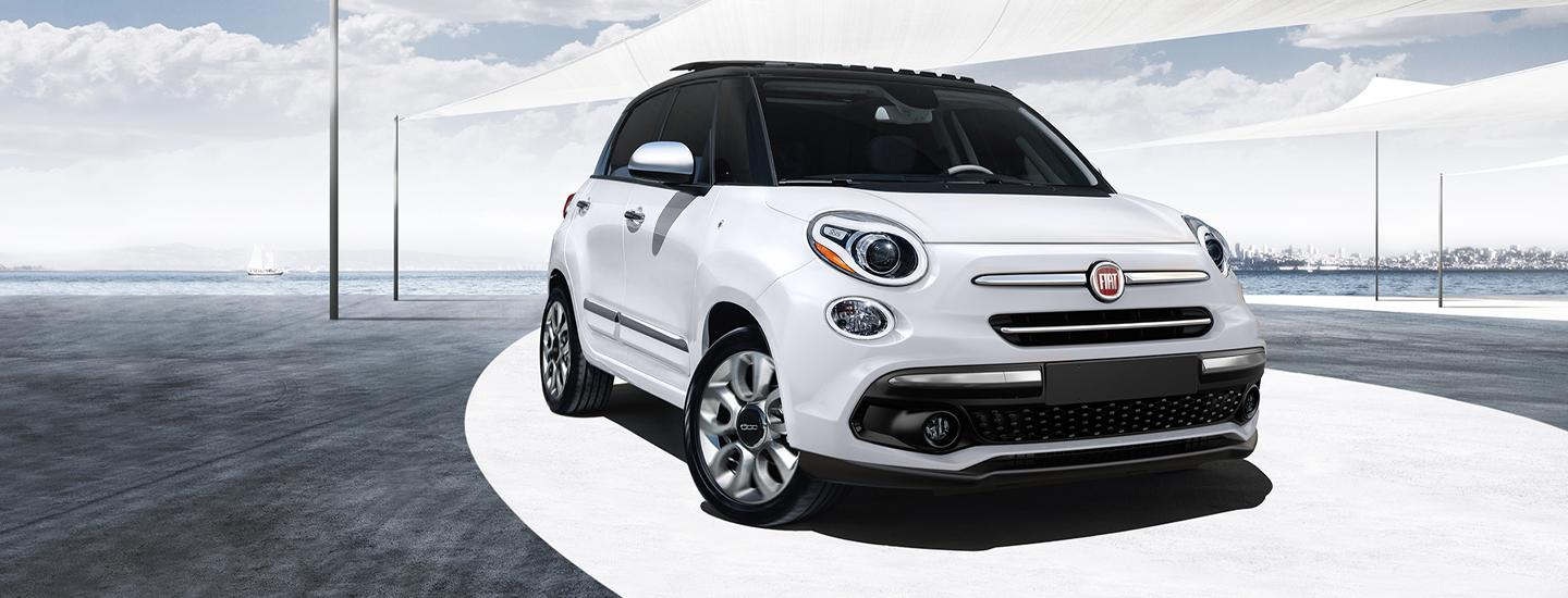 2020 FIAT 500L parked with ocean in the background