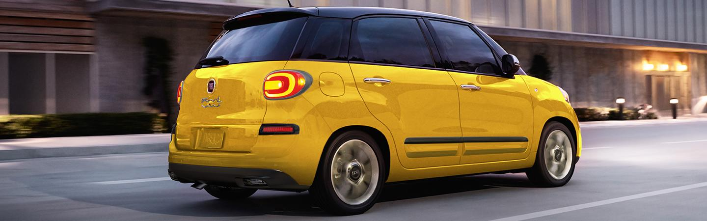 Side view of the 2020 FIAT 500L driving through a city