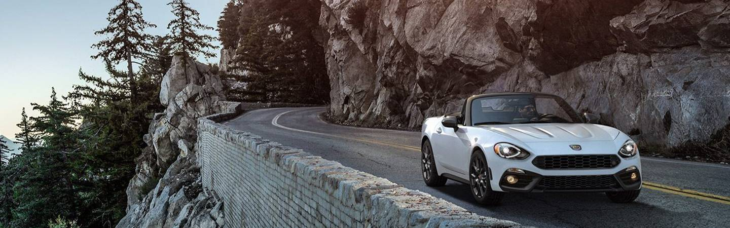 FIAT 124 Spider riding on a mountain side