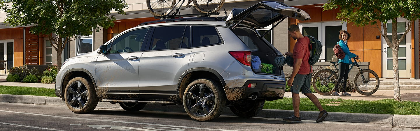 Side view of a sliver 2020 Honda Passport with its trunk open