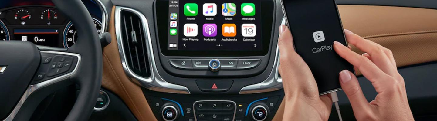 Close up view of a phone syncing with Apple CarPlay®