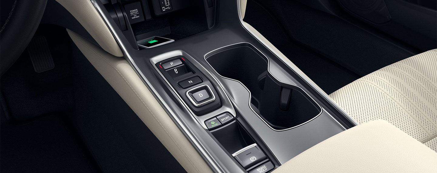 Driver side controls and cup holders of the 2018 Honda Accord
