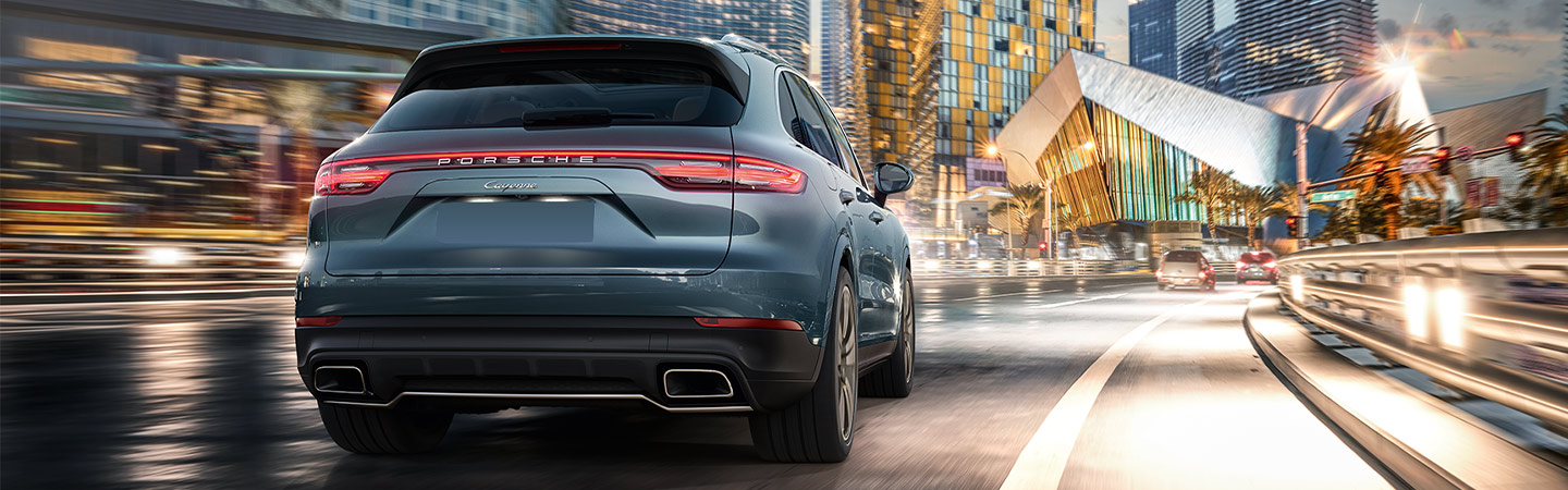 Rear view of a blue Porsche Cayenne