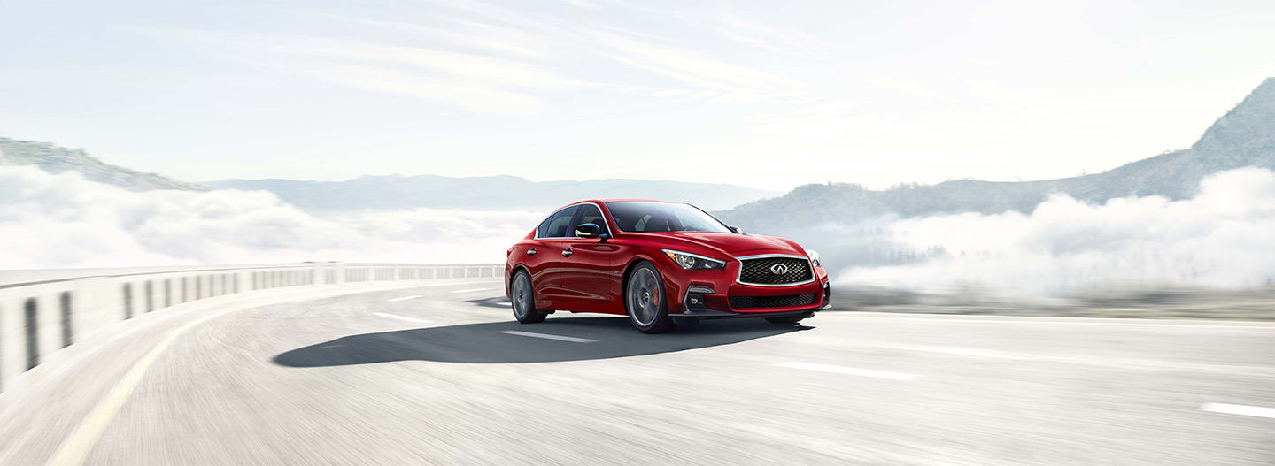 Front right side of the 2018 INFINITI Q50 driving on a bridge