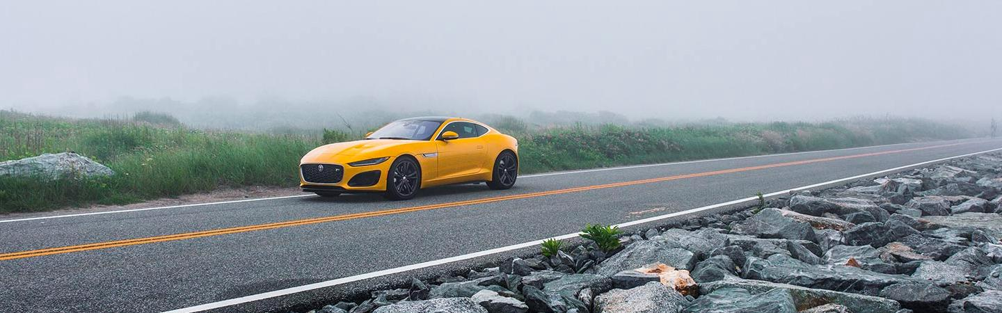 2021 Jaguar F-Type parked on a foggy road