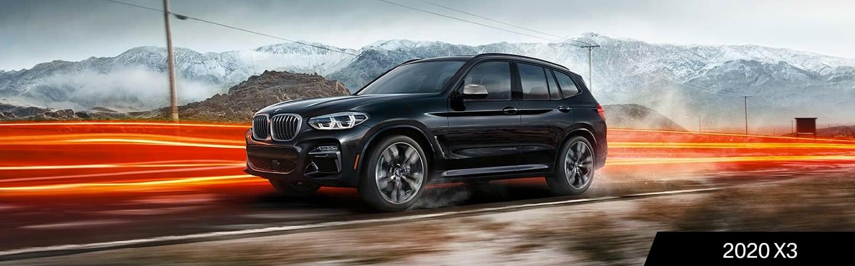 Black 2020 BMW X3 in motion