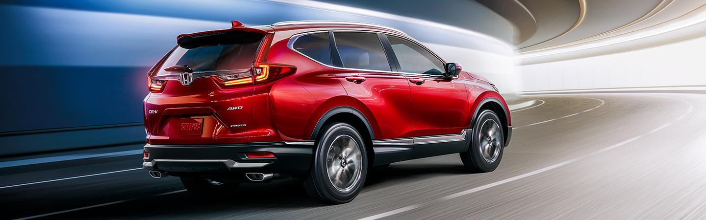 Rear view of red 2020 Honda CR-V in motion