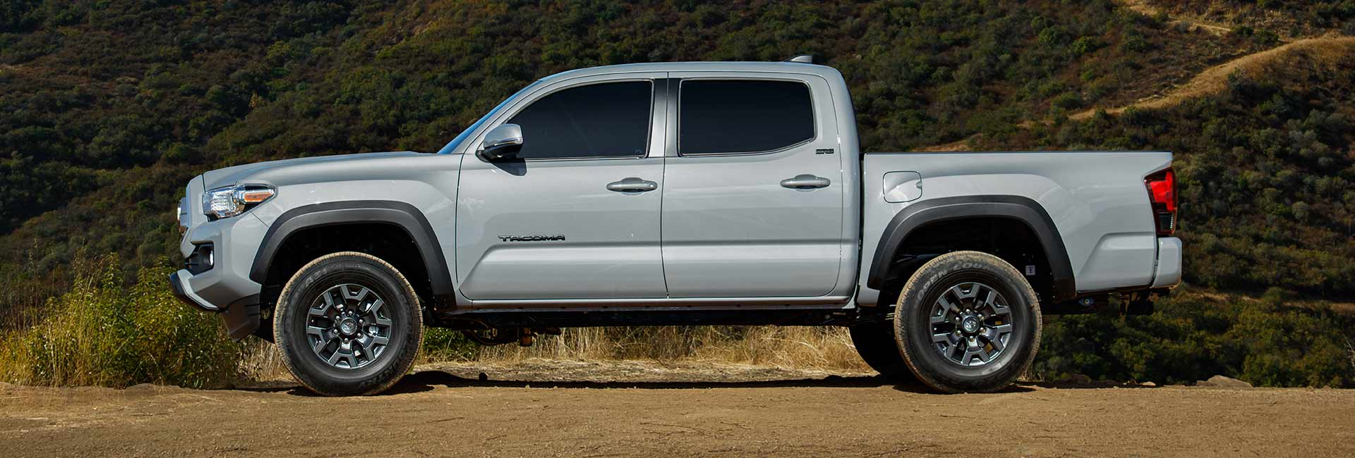 2021 silver Toyota Tacoma parked on a dirt road
