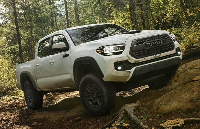 2021 white  Toyota Tacoma off-roading