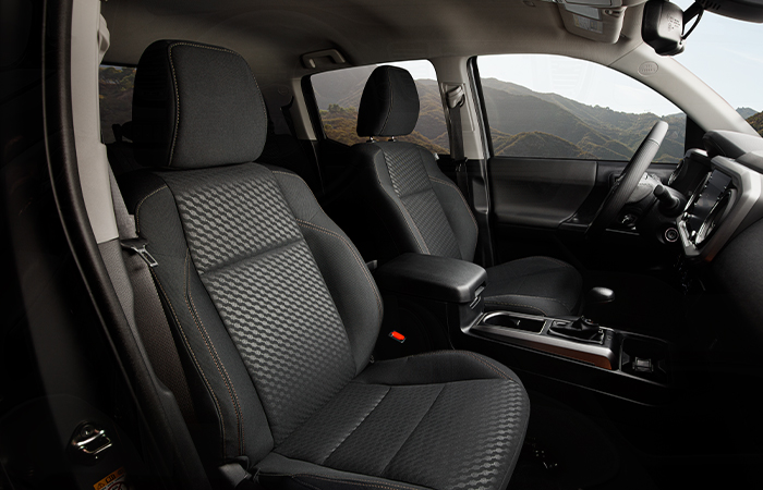 Sleek interior driver and passenger seats in a Toyota Tacoma