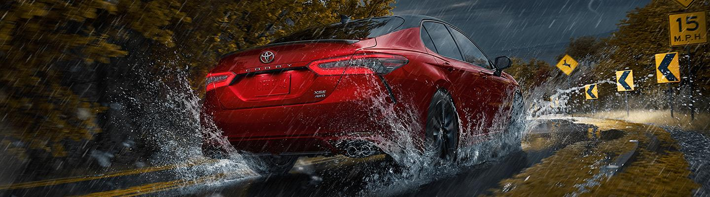 Toyota Camry driving in the rain