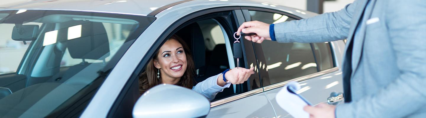 A women getting keys to her new Toyota
