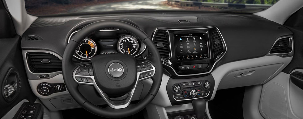 Safety features and interior of the Jeep Cherokee - available at our car dealership near Edmond.