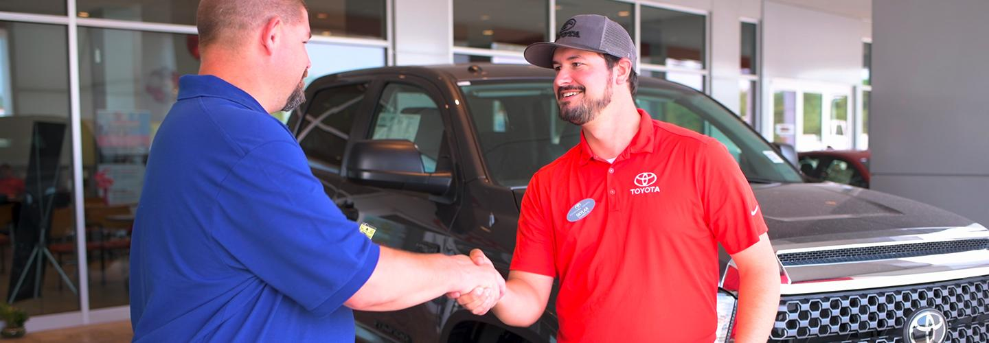 Finance Center staff at Rivertown Toyota shaking hands