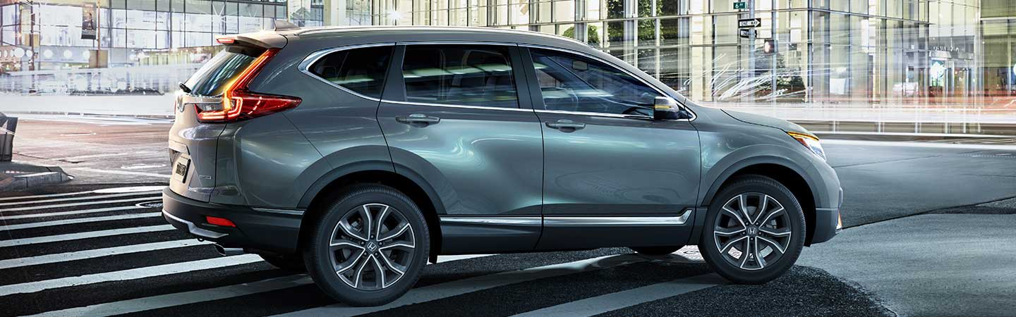 Side view of the grey 2020 Honda CR-V in motion