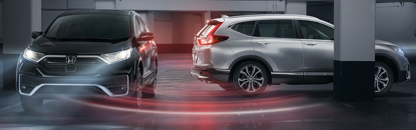Side view of two 2020 Honda CR-V parked inside