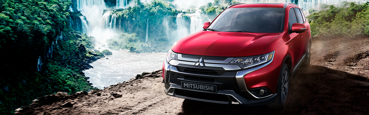 2020 Mitsubishi Outlander driving on a dirt road