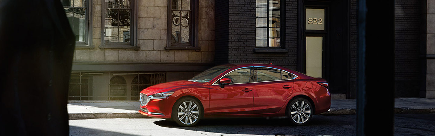Side profile of the 2019 Mazda6 parked