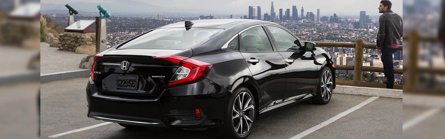 Side rear view of the 2020 Honda Civic parked in a lot