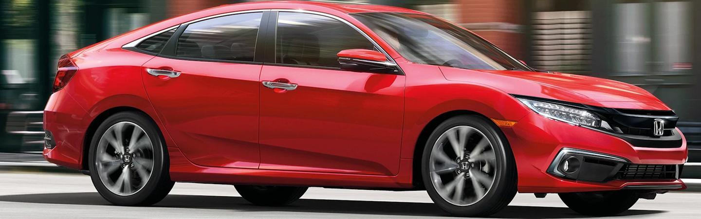 Side view of a red 2020 Honda Civic in motion