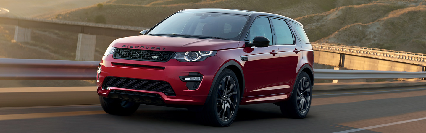 Red Land Rover Discovery Sport in motion