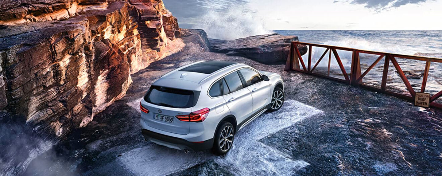 BMW X1 parked on the side of a cliff