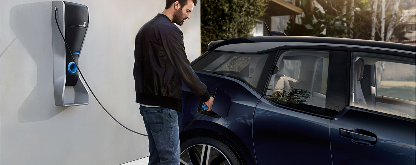 Man plugging in the BMW i3