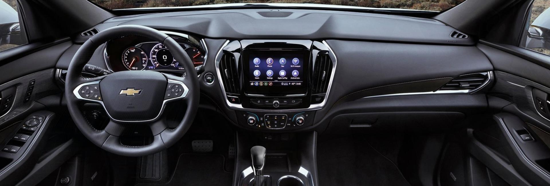 Close up view of a Chevy Traverse's steering wheel and dashboard