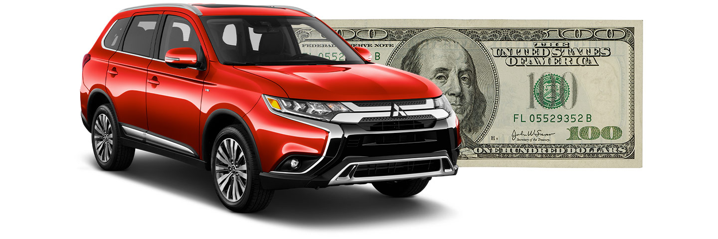 Mitsubishi CUV with $100 bill behind it