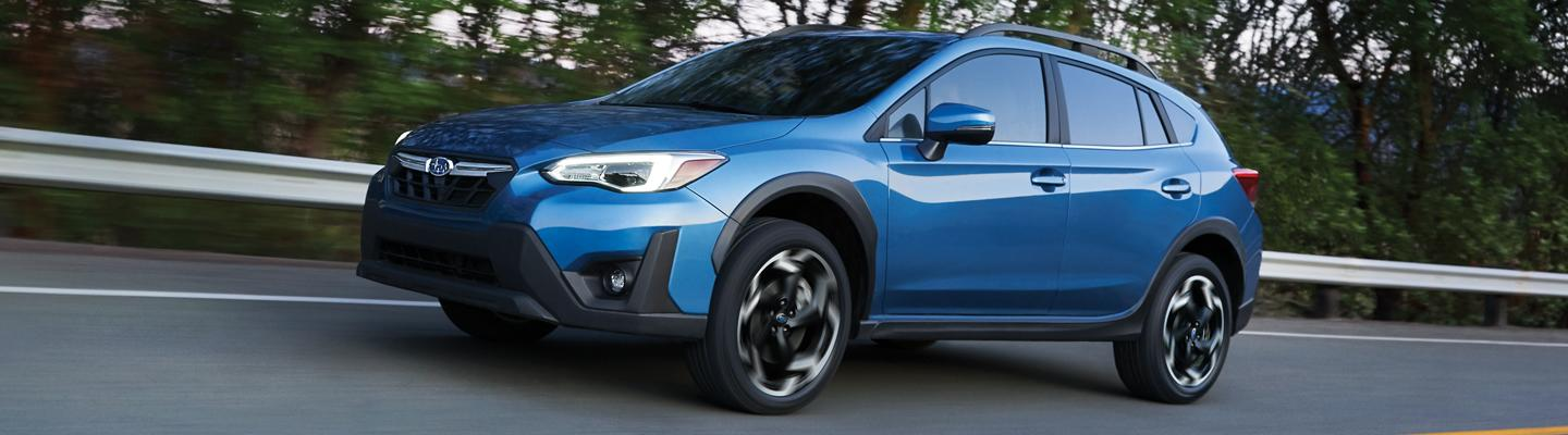 Blue Subaru Crosstrek Driving on Highway