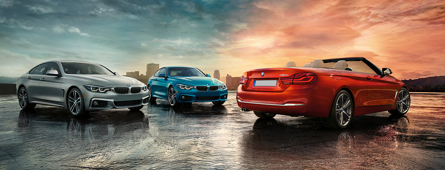 Three 2020 BMW 4 Series models parked on the road