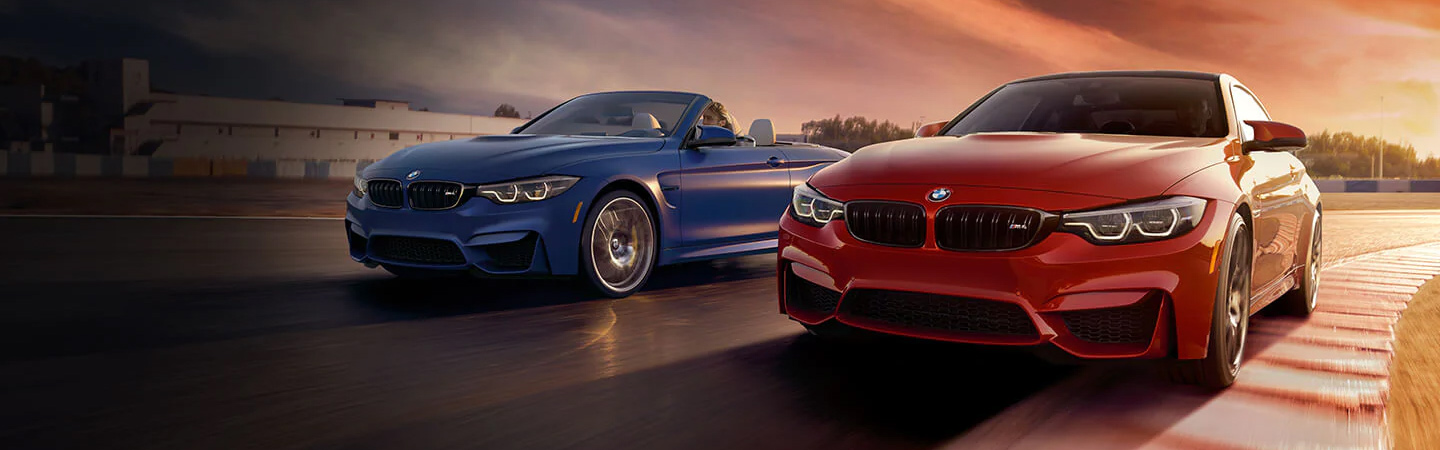 Two 2020 BMW 4 Series models driving together
