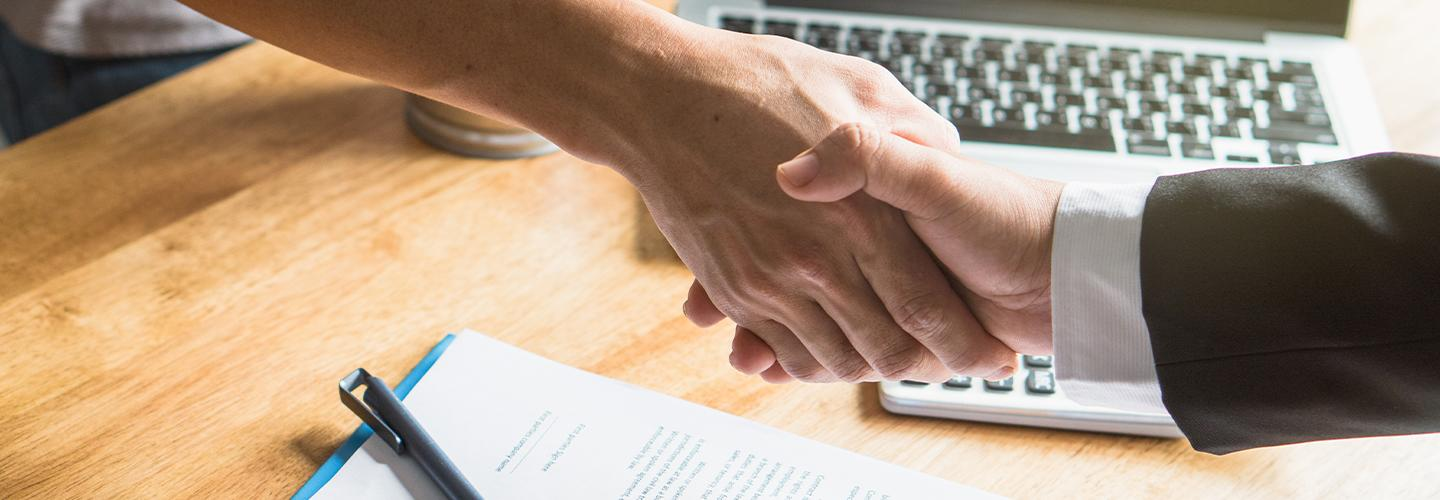 A handshake on making an auto deal
