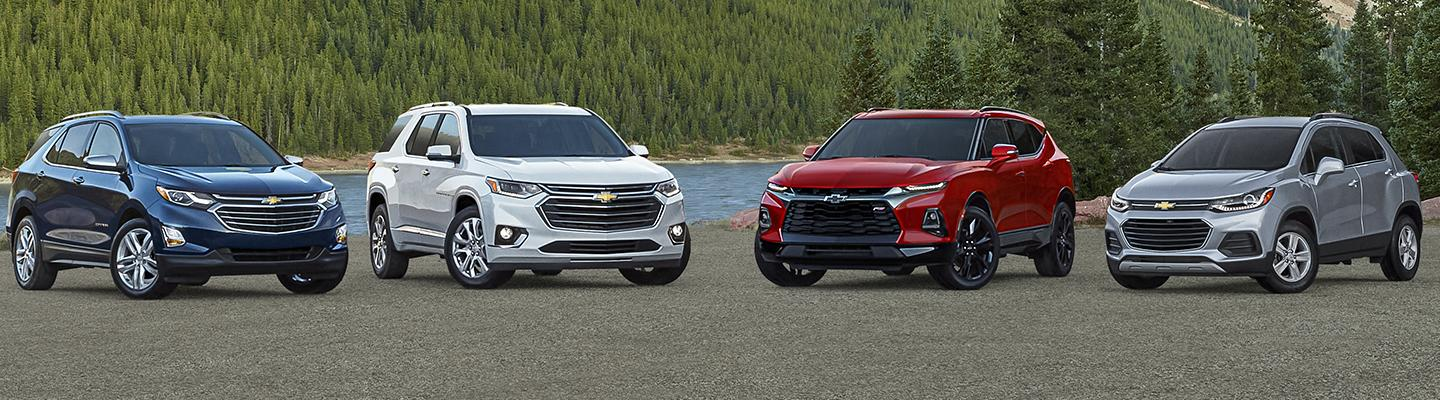 A 2021 Chevy Traverse lineup looking over a lake and forest