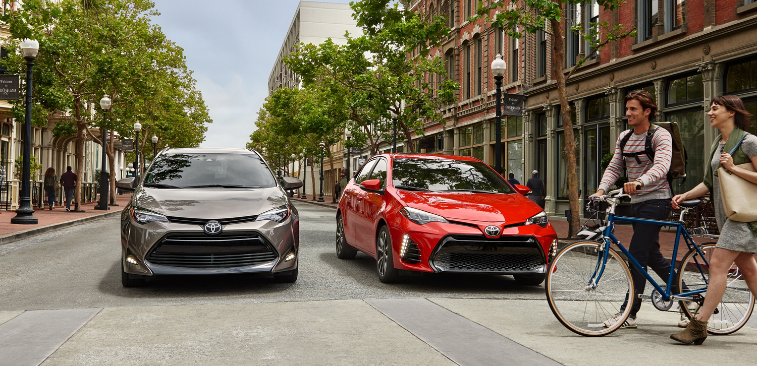 Pair of 2019 Toyota Corolla Vehicles parked at a crosswalk.