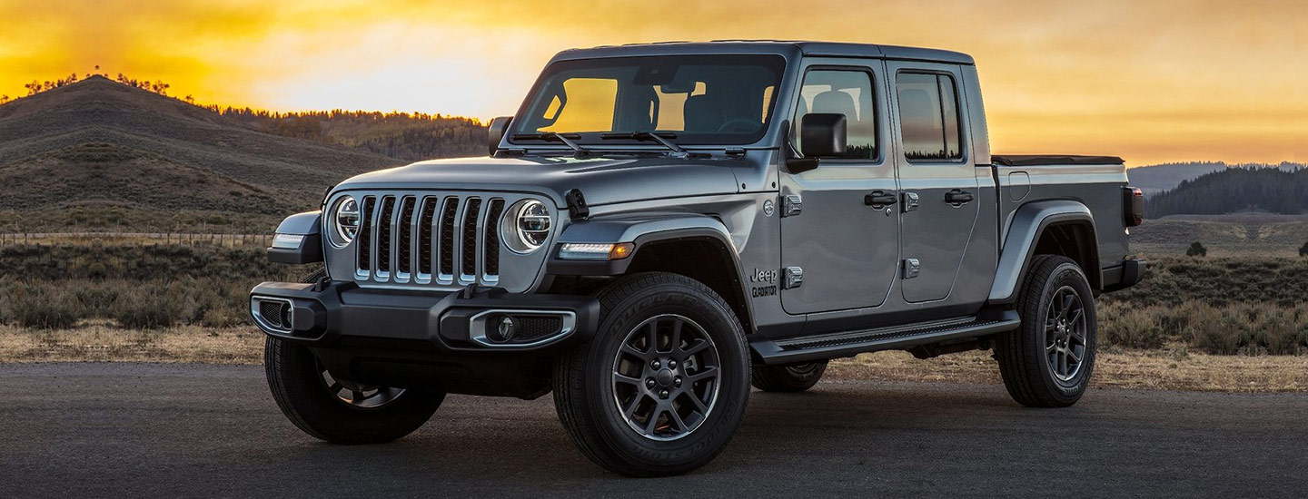 Gray 2020 Jeep Gladiator parked, sunset in background