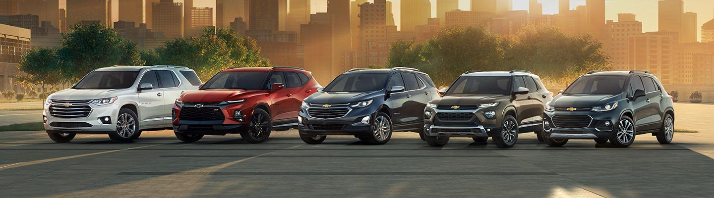 A line up of Chevy SUV's
