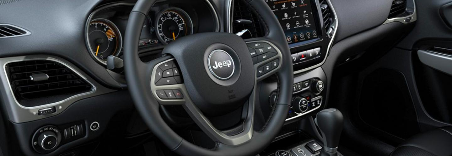 Close up of the steering wheel of a 2020 Jeep Cherokee