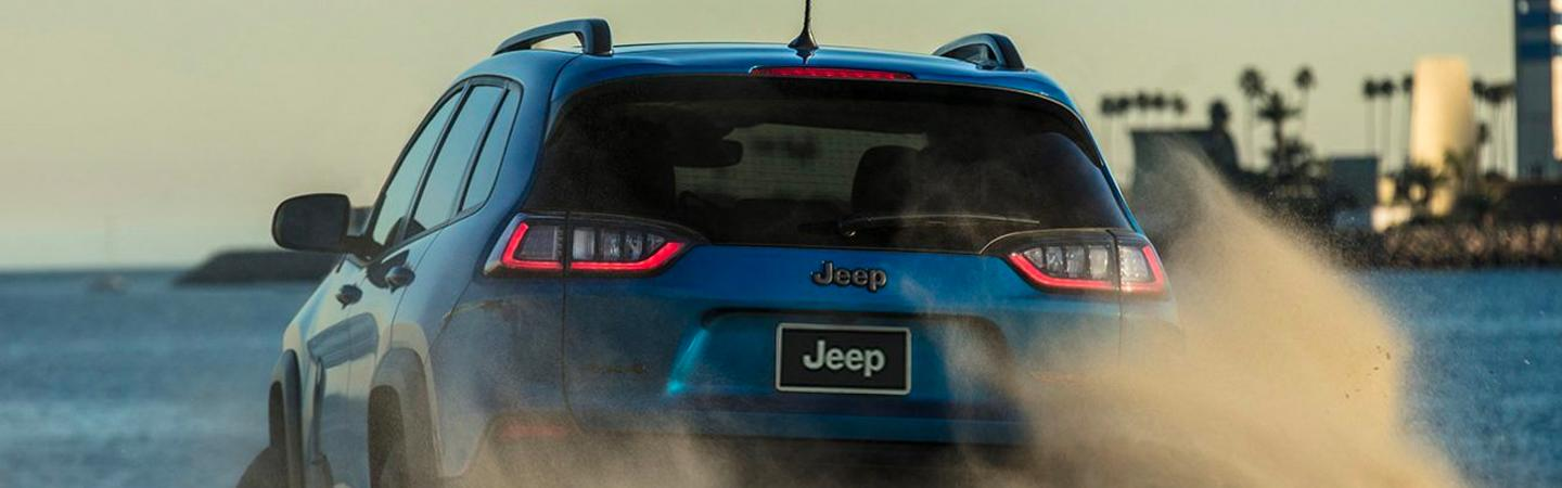 Rear view of a blue 2020 Jeep Cherokee